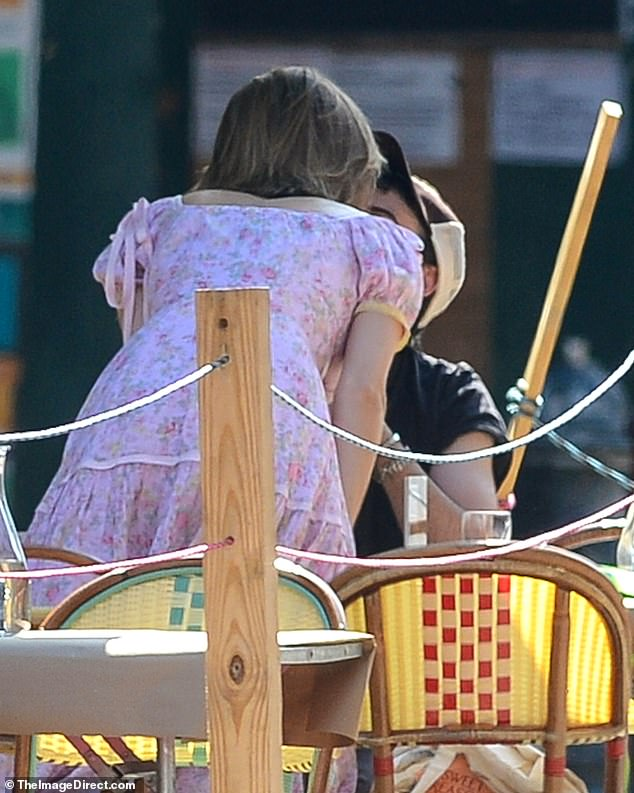 Loved-up: The actor pair looked very cosy as enjoyed a smooch while sitting outside a restaurant