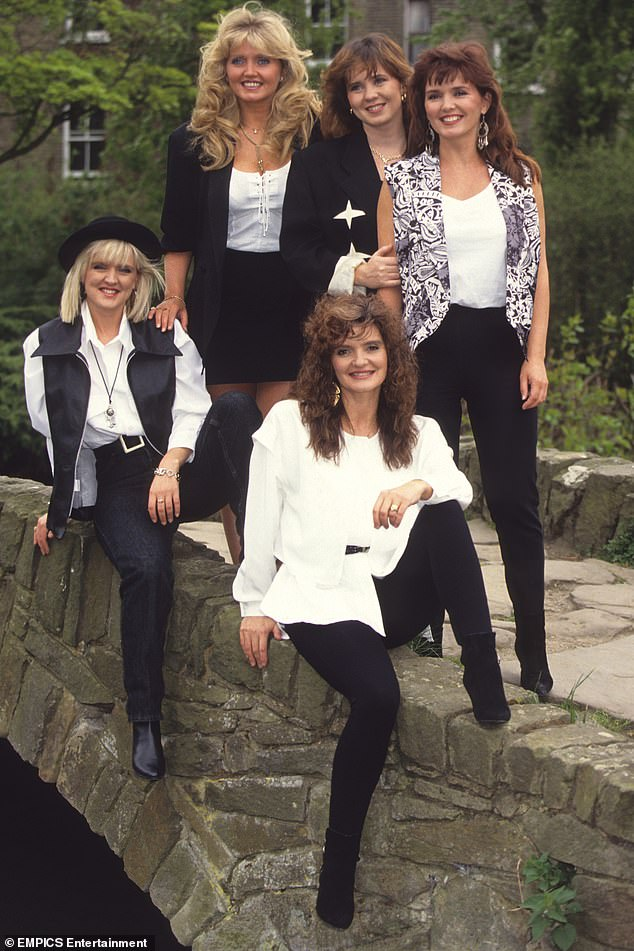 The Nolans are pictured above (from left to right) Linda, Coleen and Maureen, while Bernie and Anne are pictured in the front row