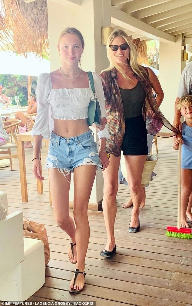 Leaving a restaurant in Ibiza, Kate, 46, smiled as Lila stepped forward in denim shorts and a white cropped top