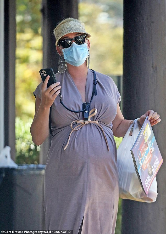 Katy Perry stays vigilant as she keeps pepper spray close while fetching food