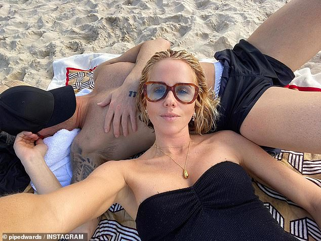 Flaunting it like Kyly! One particularly racy photo taken in Noosa showed the activewear designer leaning her head onto Michael's bare chest as they relaxed at the beach