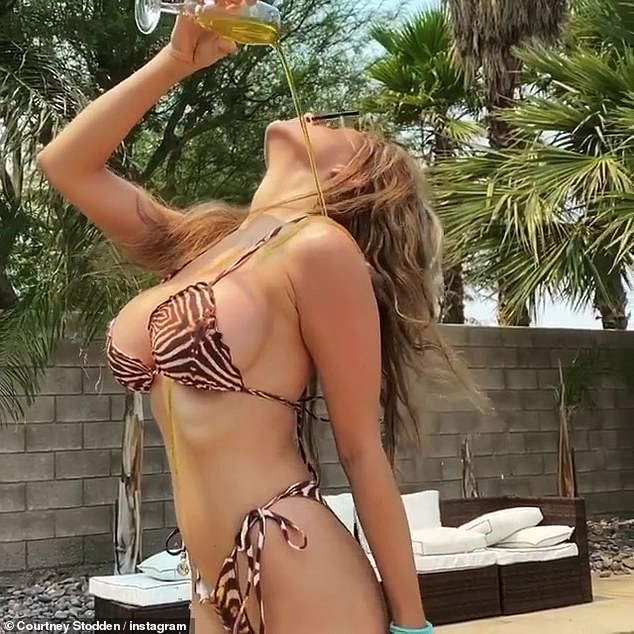 On display: The blonde put on an alluring display in a skimpy animal print bikini as she poured oil down her chest and writhed around to her new song Side Effects
