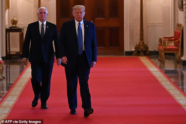 President Donald Trump (R) and Vice-President Mike Pence (L) arrive to participate in a roundtable with stakeholders positively impacted by law enforcement, in the East Room of the White House last month