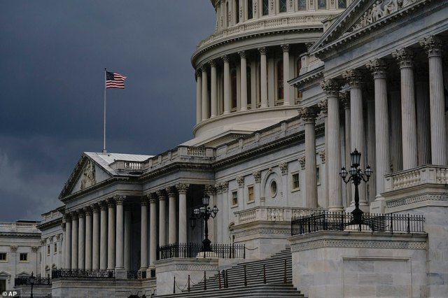 Dark clouds and heavy rain sweep over the U.S. Capitol in Washington, DC, on Monday hours before Hurricane Isaias makes landfall in the Carolinas