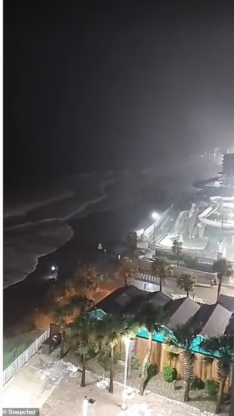 The images above show storm surge covering the coastline of Myrtle Beach, South Carolina, late on Monday