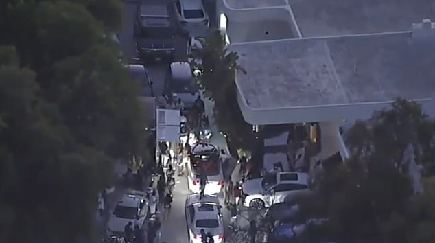 The Los Angeles Fire Department said that one person was in 'grave condition' and two others were 'critical' after a burst of gunfire at the Mulholland Drive property at around 12.45am (pictured: still from video shows the party pre-shooting)