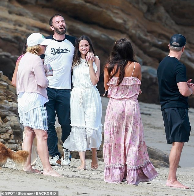 Close-knit: Ben and Ana appeared to be posing for a photo as Matt and his wife Luciana stood by