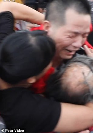 Footage shows vZhang Yuhuan, 52, embracing his mother and his ex-wife after being declared a free man in China