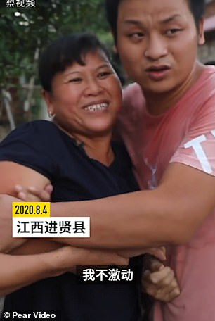 Mr Zhang's ex-wife, Song Xiaonv, and their younger son are seen waiting for the man to return after he was declared a free man on Tuesday.