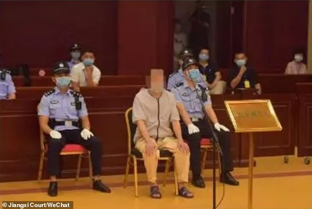 A handout shows Mr Zhang in court during a retrial on July 9 in the provincial high court