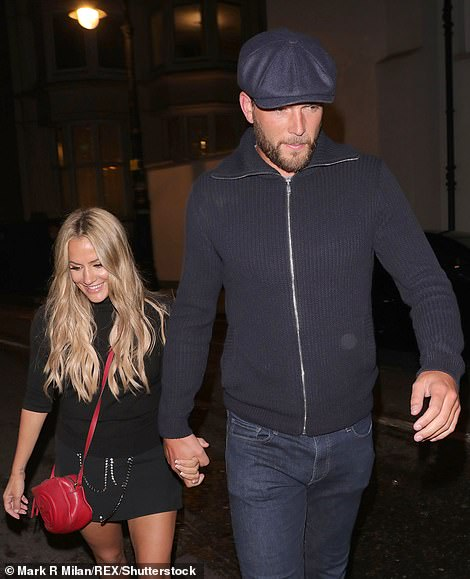 Flack with her boyfriend Lewis Burton on a night out in London in 2019