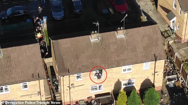 Thomas Stones (circled), 25, escaped from officers through a back window. Derbyshire Police caught the dealers during the raid in the Peak District town in December last year