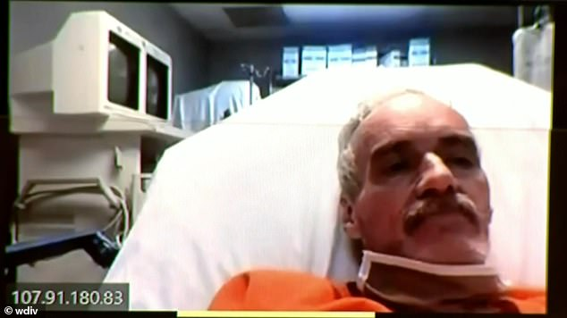 Pictured Morris being arraigned for first-degree premeditated murder from his hospital bed (pictured) earlier this month.Court documents reveal Morris was found with a bloodied baseball bat and bed sheet in his vehicle when he was pulled over and detained by officers days after Zhao's death