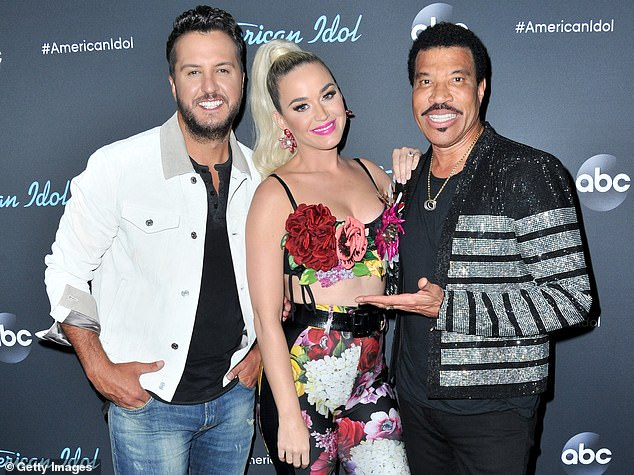 Any day now: Perry's fellow American Idol judge Luke Bryan recently gave ET an update on her delivery: 'She's pretty close' (pictured with Luke Bryan and Lionel Richie in May, 2019)