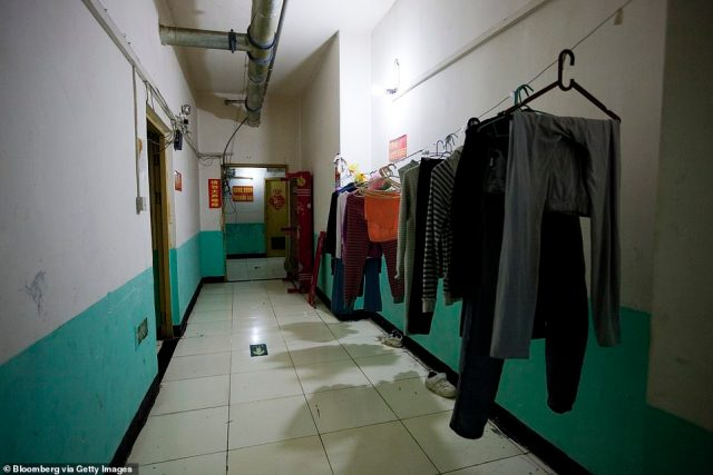 Laundry hangs at a housing complex inside a Chinese air defense bunker. Over a million people are living in subterranean tunnels in China 50 years after they were built as a bomb shelter during the Cold War