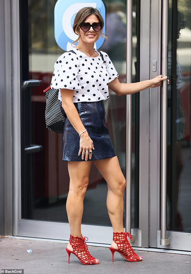 Looking good:Zoe proudly showcased her slender pins in her thigh-skimming skirt, which she paired with a black and white polka dot top with puffball sleeves