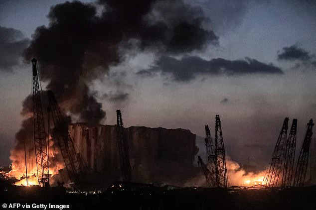 Fires burning at the port on Beirut well into the night following an explosion, believed to be from chemicals