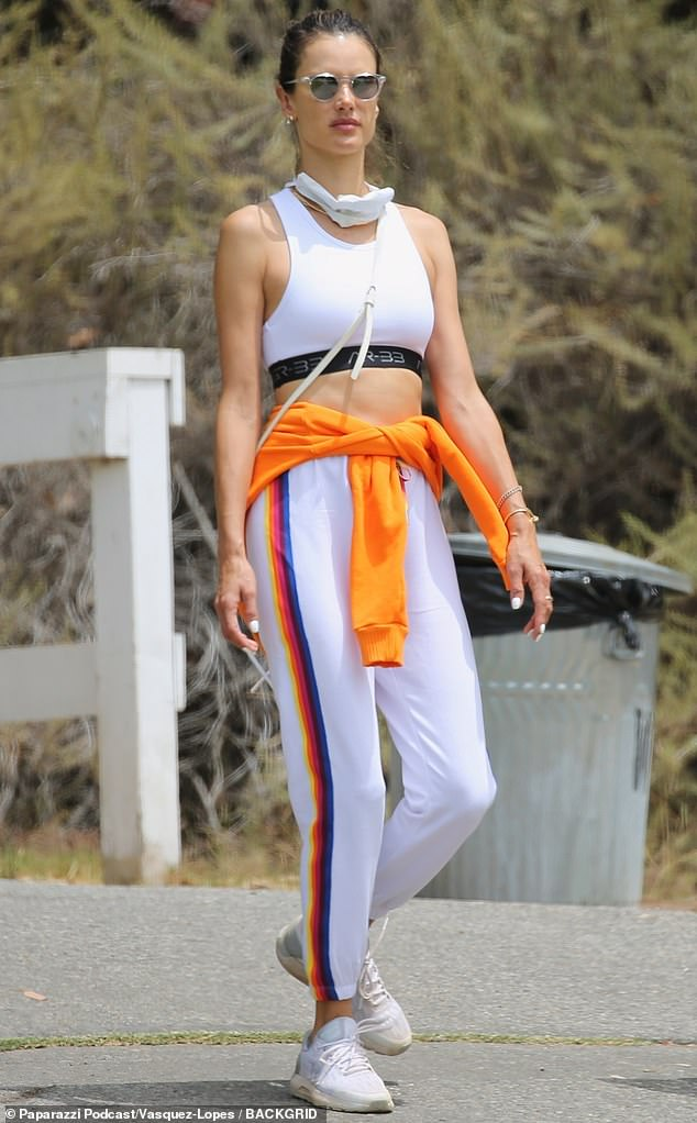 Alessandra Ambrosio flashes taut midriff in workout gear as she sticks to her fitness regime