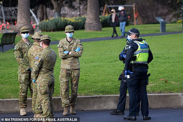 Police and ADF are seen patrolling Flagstaff Gardens on day one of the full stage four lockdown restrictions in Melbourne's CBD