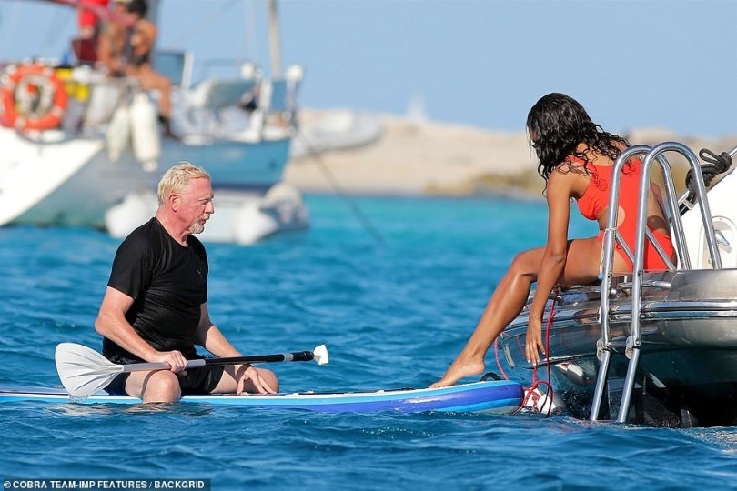 Sitting pretty: Lillian was seen pulling her boyfriend towards the boat following his paddle boarding session