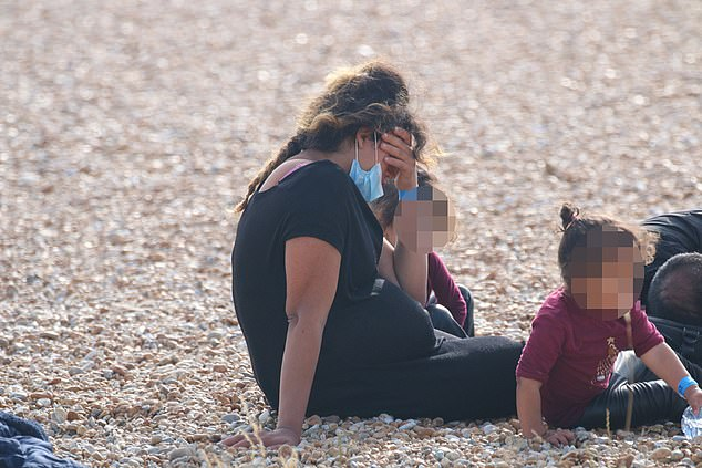 A heavily pregnant woman and young children landed at the coast in Kent today