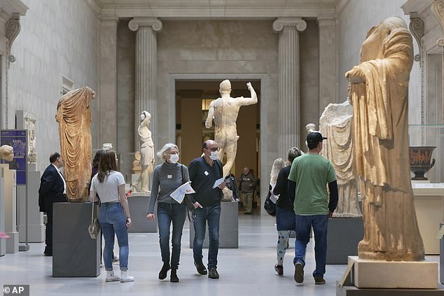 Visitors are pictured in March before the shutdown. According to a memo sent Wednesday, 79 staff members had been laid off, 181 were furloughed and 93 took voluntary retirement. Last month, Governor Andrew Cuomo said about The Met: 'I think they can plan to reopen. And then we'll see what the facts say'