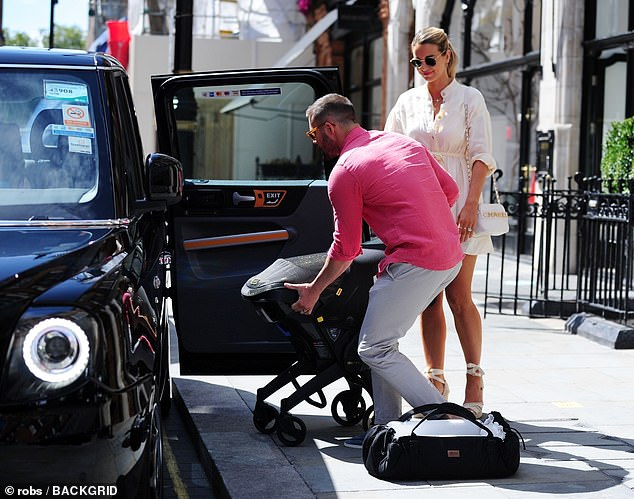Departing: After registering their daughter's birthday, both Spencer and Vogue loaded their pram into a waiting black taxi