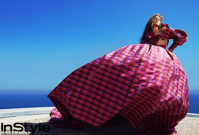 Werrrk! Coleman's skirt dramatically billowed in the wind while wearing a Christopher John Rogers FW/20 'Zinnia' plaid gown selected by her 'Image Architect' Law Roach