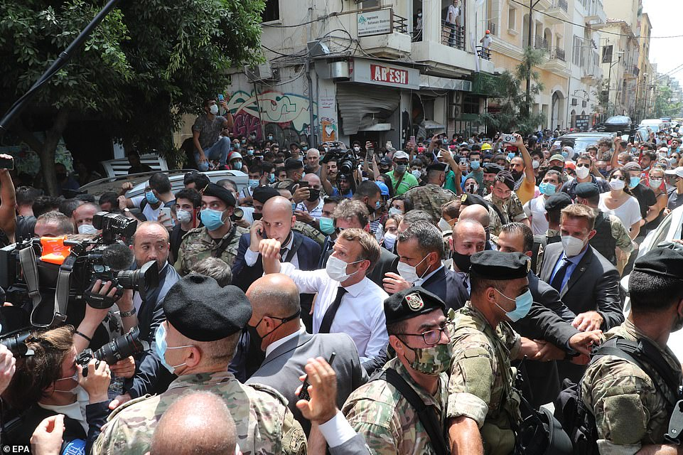 White shirt sleeves rolled up, Emmanuel Macron waded through cheering crowds in the devastated streets of Beirut earlier today where disaster survivors pleaded with him to help get rid of their reviled ruling elite