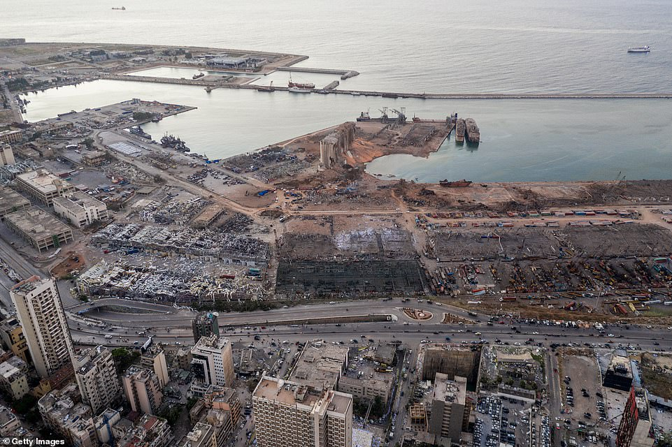 The blast almost completely destroyed the port along with a grain silo (pictured centre), which were an economic lifeline for Lebanon which was already suffering through an economic crisis