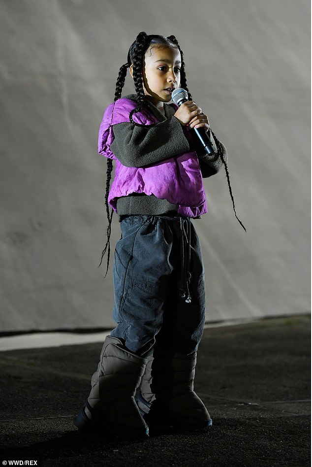 Throwback:North made her rap debut in March of this year, as she belted out lyrics while Kanye presented his Yeezy brand's Autumn/Winter 2020 collection in Paris during fashion week; North, seven, pictured March 2, 2020 at the PFW Yeezy show