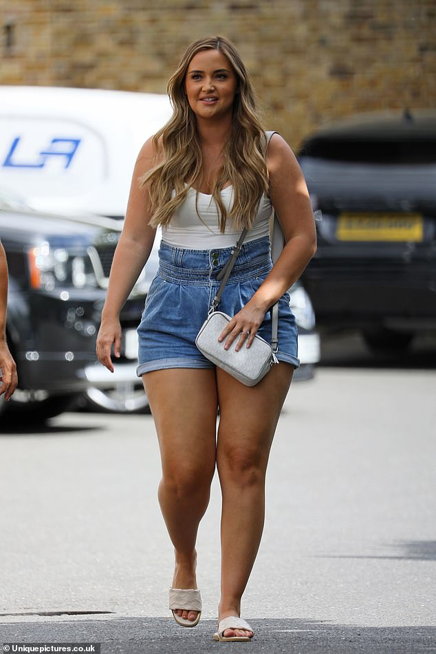 Jacqueline Jossa puts on a very leggy display in a pair of tiny denim hotpants