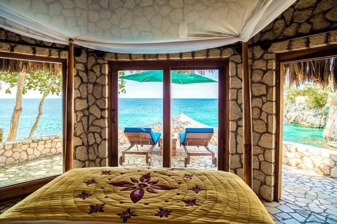 The views from the bedrooms at the property, which sits on the volcanic Jamaican coastline, are amazing