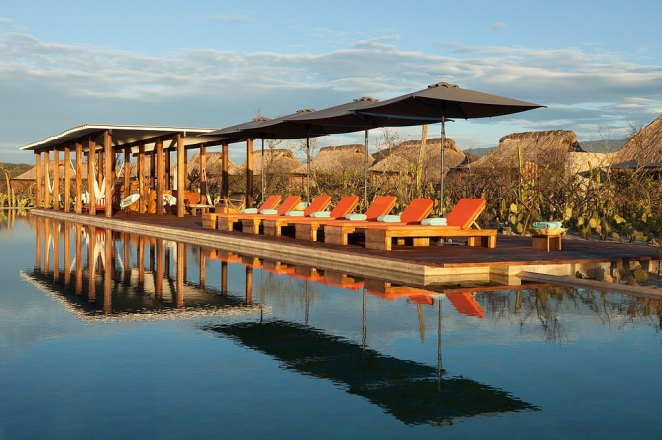 Accommodation is in the form of rustic bungalows with sea - and cactus – views