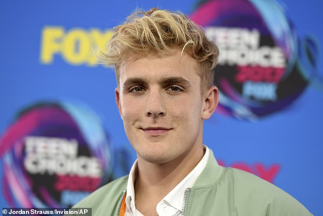 FBI and law enforcement officers raided YouTuber Jake Paul's Los Angeles mansion Wednesday and were seen removing several firearms