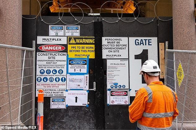 With negotiations still hanging in the air many tradesmen will not know if they even have a job on Monday (pictured, a Melbourne construction site)