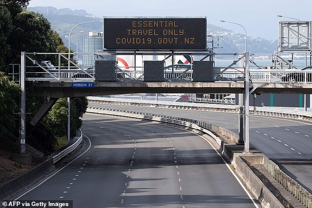 A motorway sign on theState Highway One reads 'Essential Travel Only'