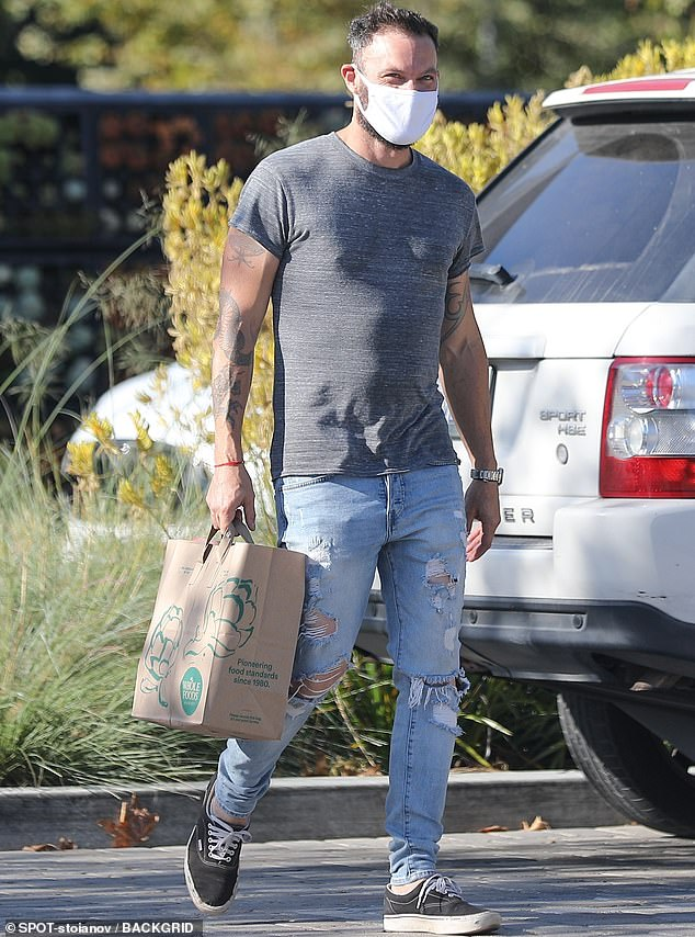 Out and about: The 47-year-old Hollywood heartthrob showed off his toned arms in a simple grey T-shirt as he headed off to Whole Foods