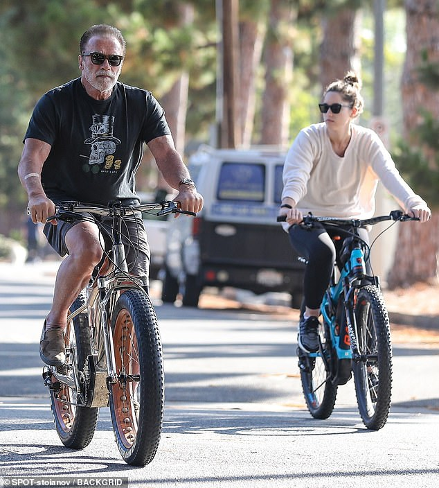 Quality time: Arnold Schwarzenegger got in some more quality time with his youngest daughter Christina, 29, on Friday, in their Brentwood, Los Angeles neighborhood