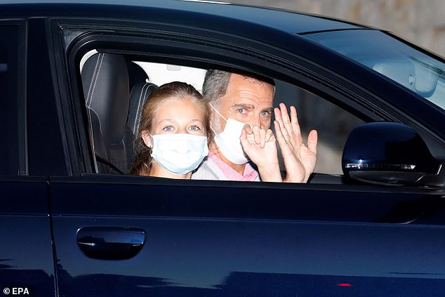 Spanish King Felipe VI (R) and Crown Princess Leonor (L) wave from a car as they arrive at the Marivent Palace in Palma de Mallorca, Balearic Islands, Spain on Saturday