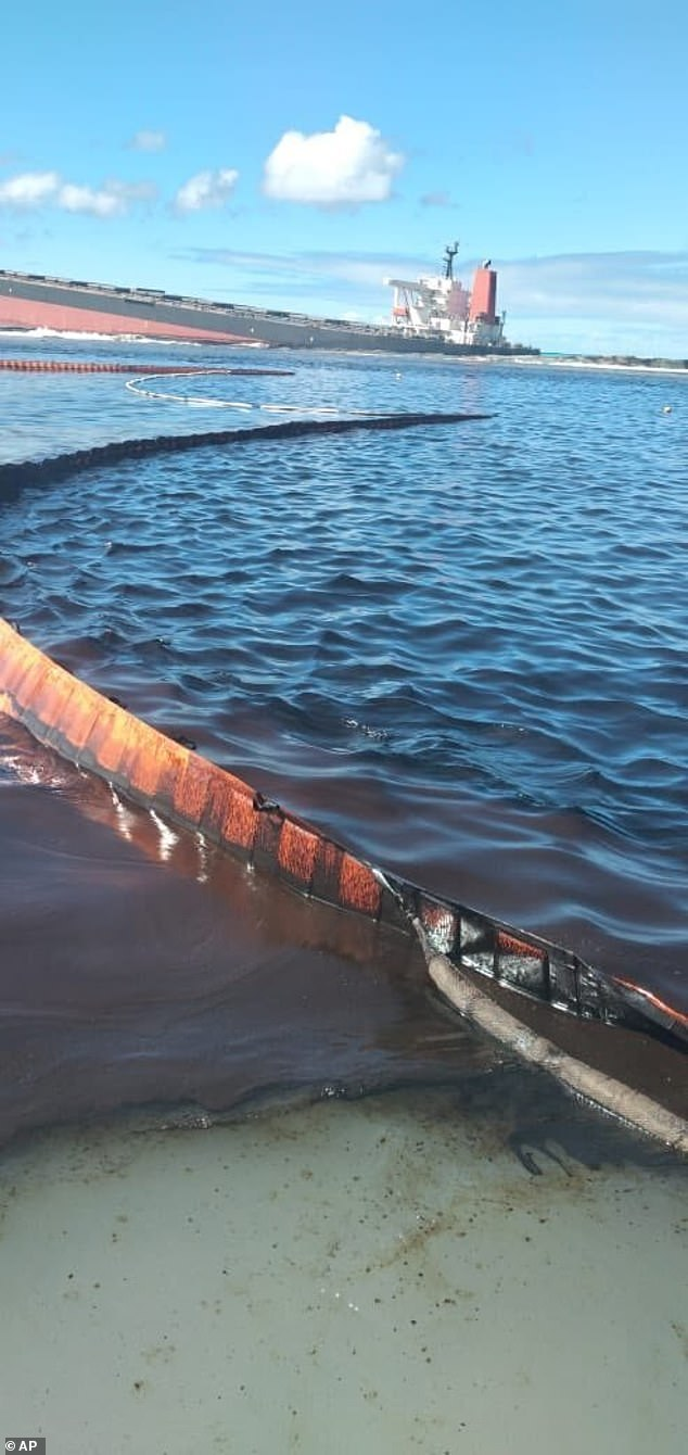 About 400 sea barriers have been positioned around the MV Wakashio in an attempt to prevent the oil from spreading further.