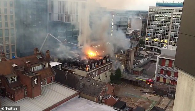 Flames could be seen spreading across the roof of the building in Bournemouth as firefighters sprayed water down from above. The building was evacuated earlier