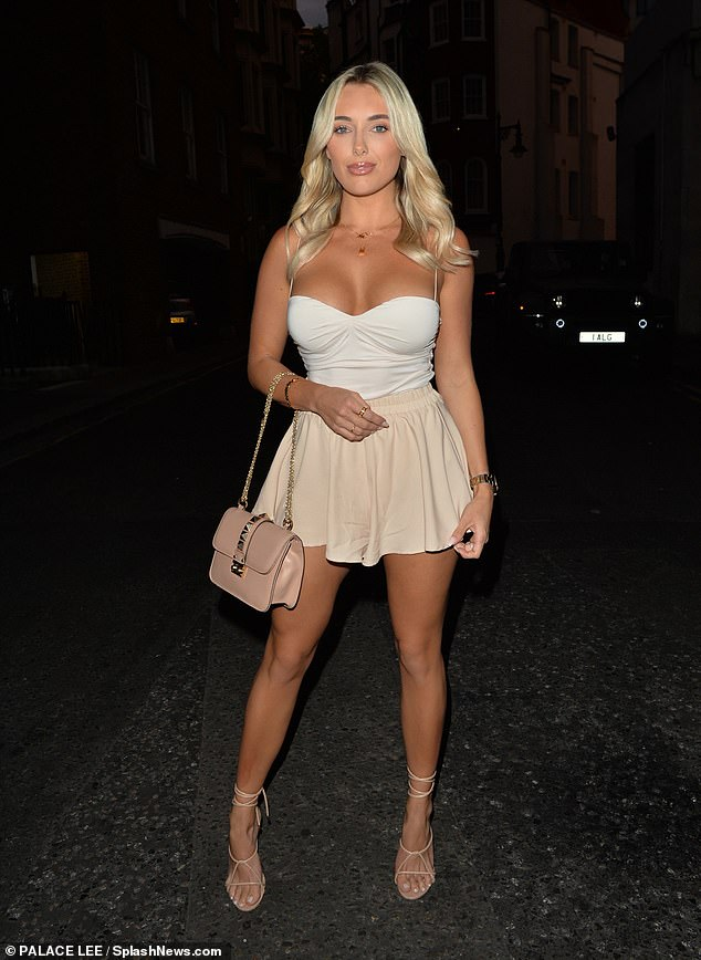 Legs for days: Amber Turner showed off her never-ending pins in a TINY beige skirt as she headed to Sexy Fish restaurant with friends in London on Saturday