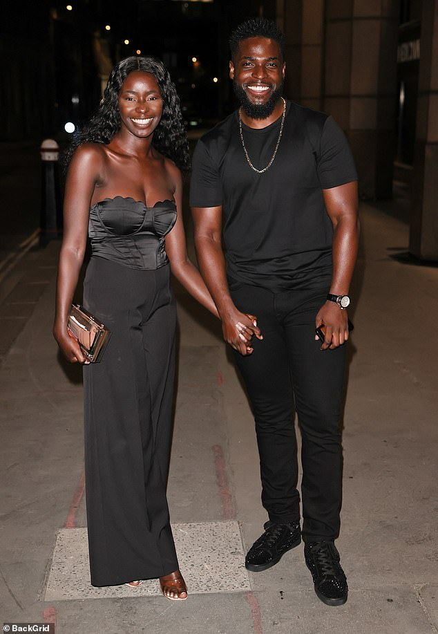 Perfect couple:Priscilla Anyabu and Mike Boateng looked happier than ever as they posed for pictures outside his surprise birthday party in London on Saturday