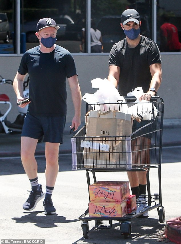 Casual: Jesse kept casual for his errand run with Justin in a black athletic tee and a pair of navy blue shorts
