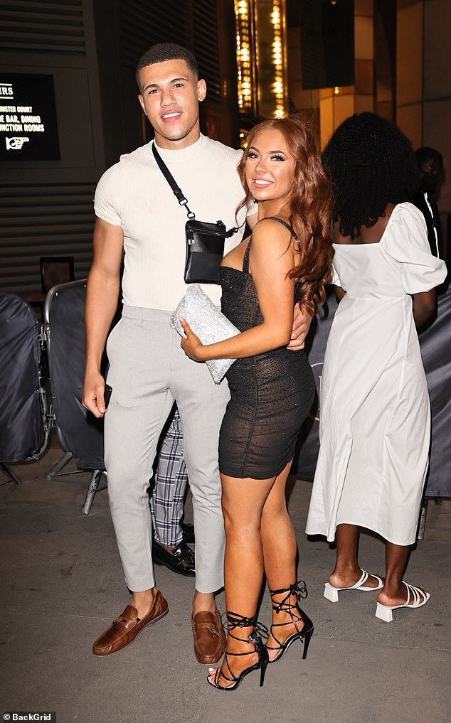 Reunited: The Love Island contestant posed for pictures with her Love Island palJordan Waobikeze who was wearing tapered stone-coloured trousers a white tee and brown loafers