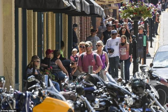 Bars and restaurants in Deadwood (pictured) and neighboring Sturgis were packed with people on Saturday afternoon