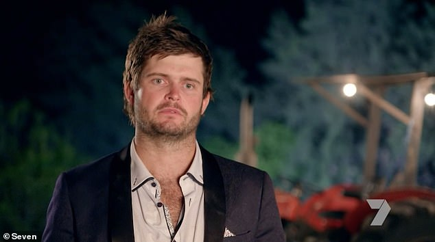 Confrontation: While attending the country ball with the other women and farmers on Sunday's episode, farmer Harry (pictured), 29, pulled Karlana aside for a private conversation