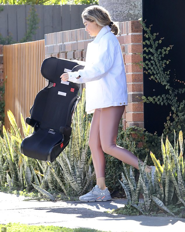 Errands: Erin was very much in mummy mode, seen carrying a child's car seat to her vehicle