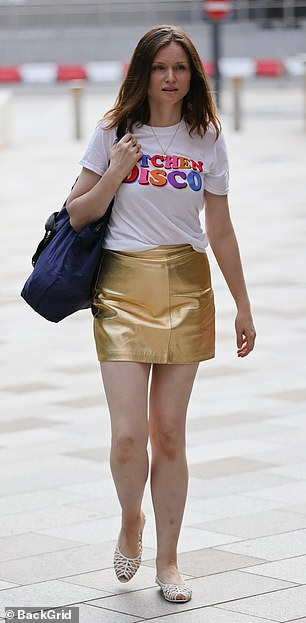 Looking good: The Murder On The Dancefloor star also wore a gold miniskirt along with a pair of white open toed flats